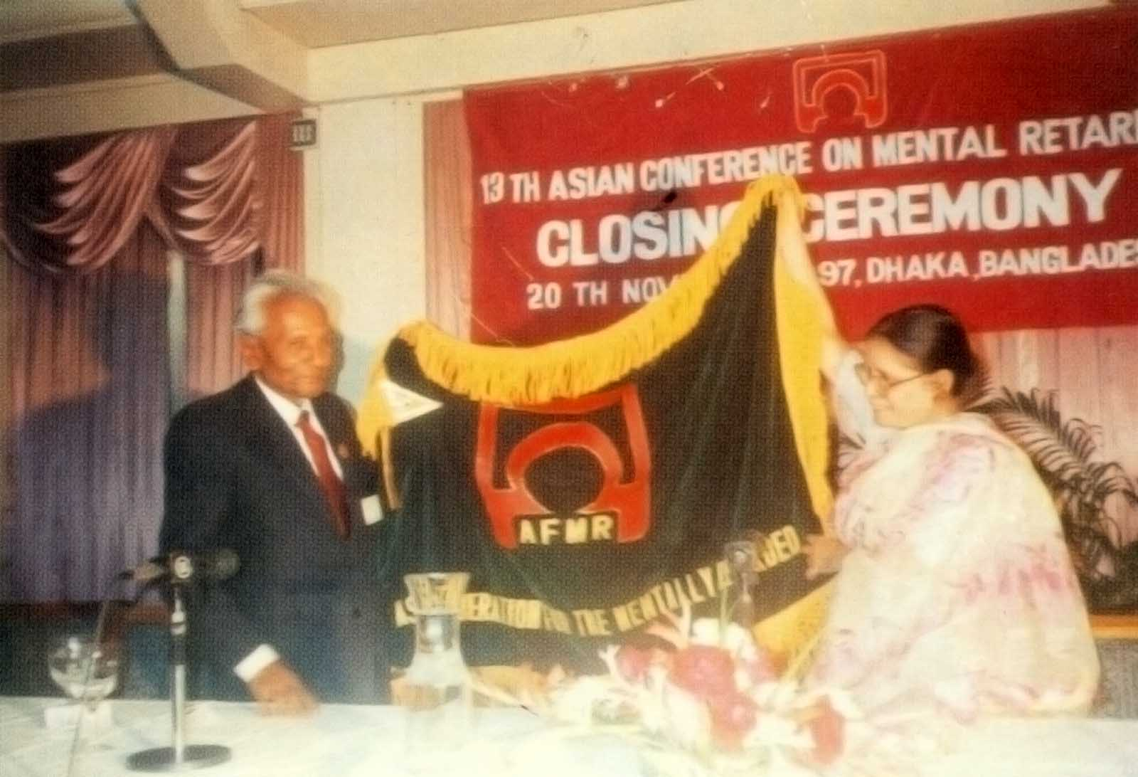 ACMR President handing over ACMR Flag to the would be ACMR President of Nepal